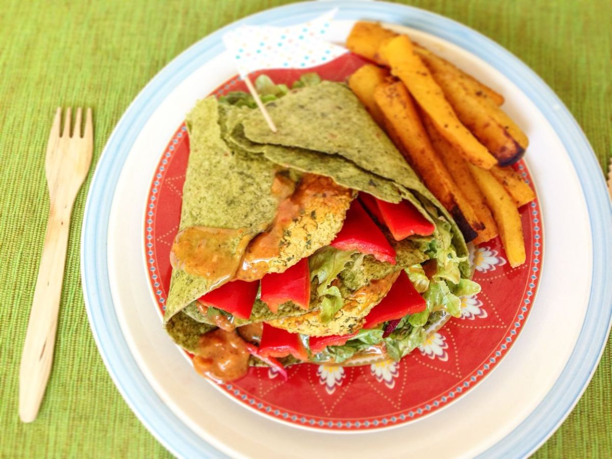 Red lentil burger wraps with curried pumpkin fries